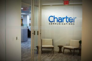 Charter staff told to report to offices despite positive coronavirus tests