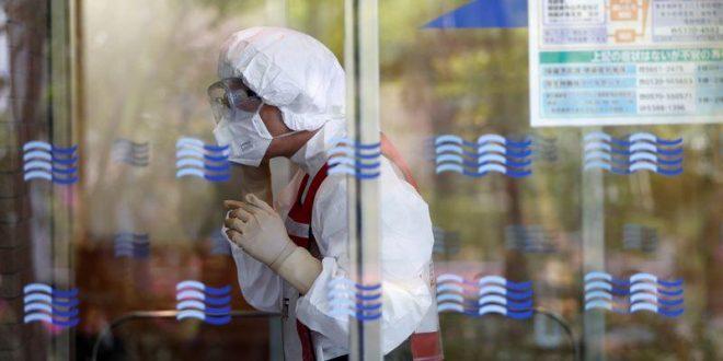 Japan COVID-19 doctors lack fresh masks, hazard pay: union survey