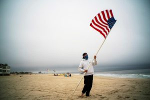 COVID-19 distancing compels shifts at the beach on crowded U.S. Memorial Day weekend