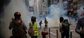 Police fire tear gas in Hong Kong as hundreds protest against proposed national security laws