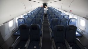 Ensure the tray table is up and your mask on: air travel in the era of COVID-19